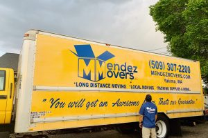 Pictured: Noe Mendez in front of a Mendez Movers moving truck.