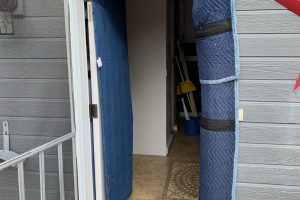 This image shows a doorway protected for a house move.